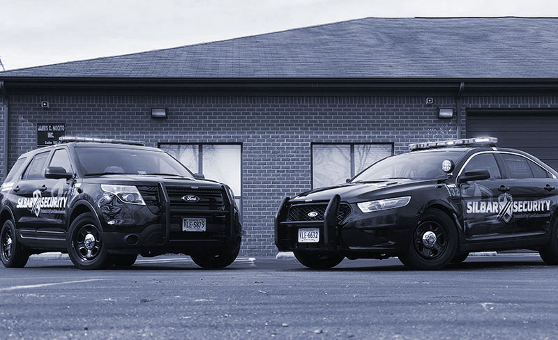 two security cars parked next to each other